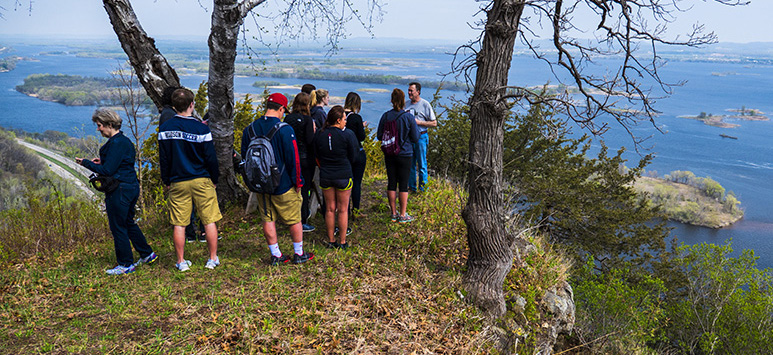 Leading nature hike overlooking Mississippi River from blufftop