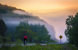 bicycling into foggy sunrise (c) Timothy Jacobson