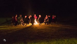 Friends enjoying conversation around a campfire (c) Timothy Jacobson