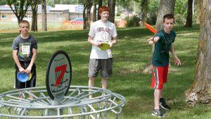 teens disc golfing