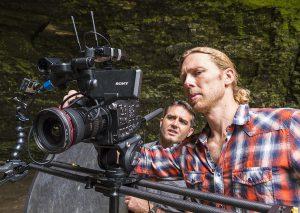 Jonas Stenstrom adjusts camera as Rob Nelson looks on