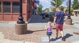 father-daughter time on a small town main street