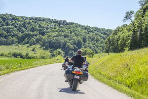 cruising down Driftless road on motorcycle