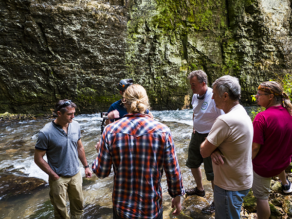 Untamed Science and Sustainable Driftless crew filming at a cave site